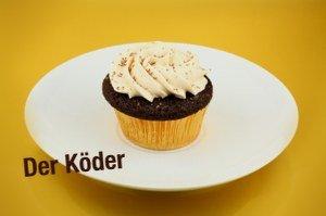 """Ein Schokoladenkuchen mit der Beschriftung """"Köder"""""""